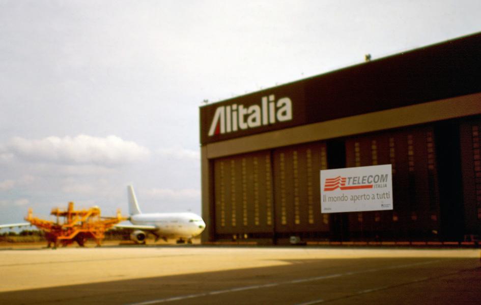 "TELECOM <font face=""Verdana, Arial, Helvetica, sans-serif"" size=""2""> 1998 Hangar Alitalia Fiumicino </font>"